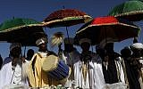 Israeli 'Kessim' or religious leaders of the Ethiopian Jewish community lead the prayers during the Sigd holiday marking the desire to 'return to Jerusalem', as they celebrate from a hilltop in the holy city, on November 16, 2017. (AFP PHOTO / GALI TIBBON)