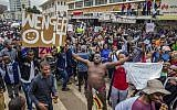 People carry placards and react during a demonstration demanding the resignation of Zimbabwe's president on November 18, 2017 in Harare. (AFP/Jekesai Njikizana)