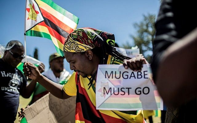 People celebrate during a demonstration demanding the resignation of Zimbabwe's president on November 18, 2017 in Pretoria, South Africa. (AFP PHOTO / GULSHAN KHAN)