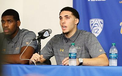 This file photo taken on November 14, 2017 shows LiAngelo Ball and Cody Riley (L) of the UCLA Men's Baskeball team speaking to the media during a press conference at Pauley Pavilion in Los Angeles, California. (AFP PHOTO / GETTY IMAGES NORTH AMERICA / Josh Lefkowitz)