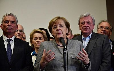 German Chancellor and leader of the Christian Democratic Union (CDU) party, Angela Merkel, speaks after talks on forming a new government broke down on November 19, 2017 in Berlin.  (AFP Photo/Tobias Schwartz)