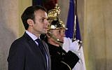 French President Emmanuel Macron stands at the main entrance of the Elysee Palace on November 20, 2017 in Paris. (AFP PHOTO / LUDOVIC MARIN)