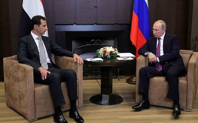 Russia's President Vladimir Putin, right, meets with his Syrian counterpart Bashar Assad in Sochi, Russia, on November 20, 2017. (AFP/SPUTNIK/Mikhail KLIMENTYEV)
