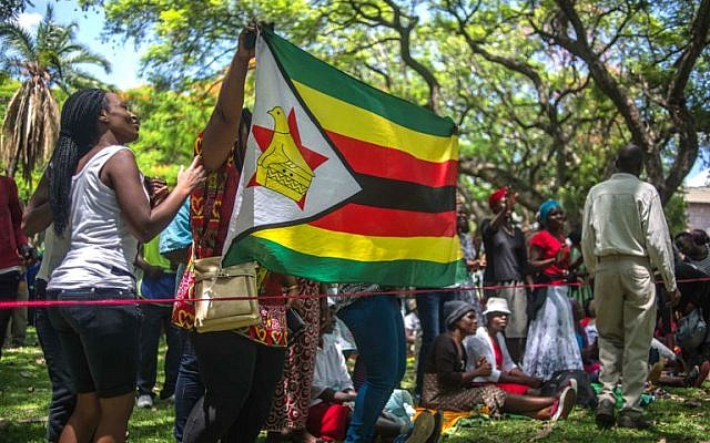 Zimbabweans gather at Unity Square opposite parliament to protest against Zimbabwean President Robert Mugabe in Harare, November 21, 2017. (AFP)