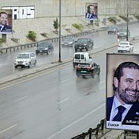 "A poster bearing a portrait of Lebanese Prime Minister Saad Hariri reads in Arabic ""There is no hapiness without Saad"" is seen on a billboard on Beirut's airport highway, on November 21, 2017. (AFP/JOSEPH EID)"