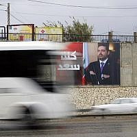 "A poster bearing a portrait of Lebanese Prime Minister Saad Hariri reads in Arabic ""We are all Saad"" is seen in Beirut, on November 21, 2017. Egypt's President Abdel Fattah al-Sisi will meet Lebanese Prime Minister Saad Hariri, Cairo confirmed,  before the premier returns to Lebanon to face the political crisis over his resignation. / AFP PHOTO / JOSEPH EID"
