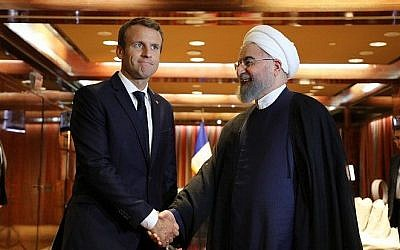 France's President Emmanuel Macron left meets his Iranian counterpart Hassan Rouhani in New York