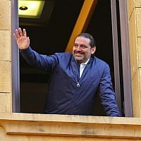 Lebanese prime minister Saad Hariri greets his supporters upon his arrival at his home in Beirut on November 22, 2017. (AFP PHOTO / STR)