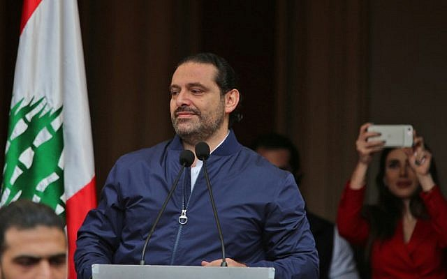 Lebanese Prime Minister Saad Hariri greets supporters upon arriving at his home in Beirut on November 22, 2017. (AFP Photo/Stringer)