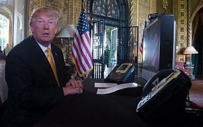 US President Donald Trump prepares his traditionnal adress to thank members of the US military via video teleconference on Thanksgiving day, from his residence in Mar-a-Lago in Florida, November 23, 2017. (AFP/Nicholas KAMM)