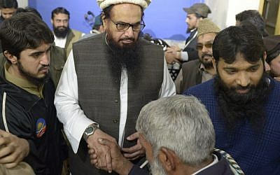 Pakistani head of the Jamaat-ud-Dawa (JuD) terrorist organization Hafiz Saeed (2L) meets with supporters after offering Friday prayers at Jamia AL Qadsia Masjid following his release in Lahore on November 24, 2017. (AFP PHOTO / STR)