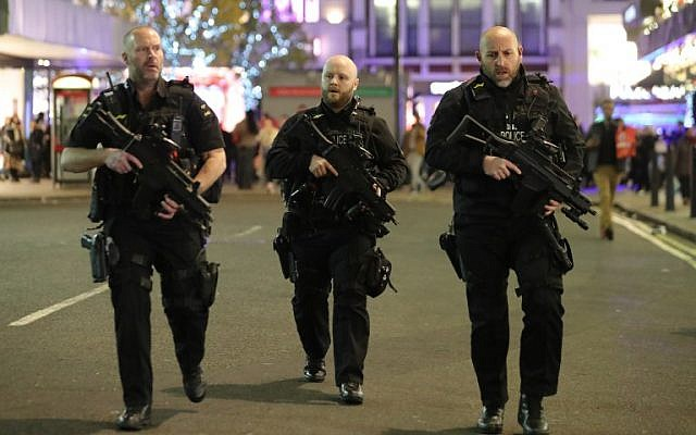 Armed police patrol near Oxford street as they respond to an incident in central London on November 24, 2017. ( AFP PHOTO / Daniel LEAL-OLIVAS)