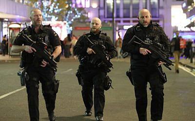 Illustrative: Armed police patrol near London's Oxford Street on November 24, 2017. (AFP Photo/Daniel Leal-Olivas)