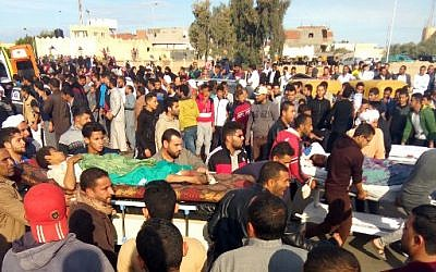 Egyptians carry victims on stretchers following a gun and bombing attack on the Rawda mosque near the North Sinai provincial capital of El-Arish on November 24, 2017. (AFP PHOTO)