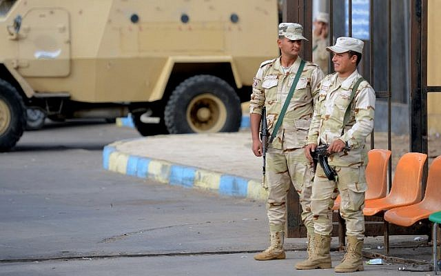 Illustrative: Egyptian army conscripts stand guard outside the Suez Canal University hospital in the eastern port city of Ismailia on November 25, 2017, where the victims of a bomb and gun assault on the North Sinai Rawda mosque a day earlier.. (AFP Photo/Mohamed El-Shahed)