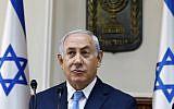Prime Minister Benjamin Netanyahu opens the weekly cabinet meeting at his Jerusalem office, November 26, 2017. (AFP/GALI TIBBON)