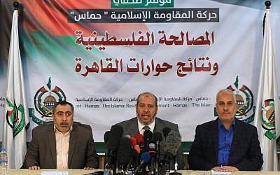 Palestinian terror movement Hamas' senior political leader, Khalil al-Hayya, center, accompanied by Hamas spokesman Fawzi Barhoum, right, attend a press conference in Gaza City on November 27, 2017. (AFP/MOHAMMED ABED)