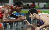 This file photo taken on August 20, 2016 shows USA's J'den Michael Tbory Cox (red) wrestling with Iran's Ali Reza Karimi during a match at the 2016 Olympic Games in Rio de Janeiro. (AFP Photo/Jack Guez)