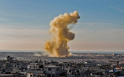 Illustrative: A picture taken on November 28, 2017, from Rafah in the southern Gaza Strip shows smoke billowing following an explosion close to the border on the Egyptian side of the divided city. (AFP Photo/Said Khatib)