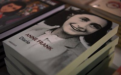 "Copies of ""The Diary of Anne Frank"" are displayed at the exhibition 'Auschwitz. Not long ago. Not far away' on November 28, 2017 at the Arte Canal Exhibition Centre in Madrid. (AFP PHOTO / GABRIEL BOUYS"