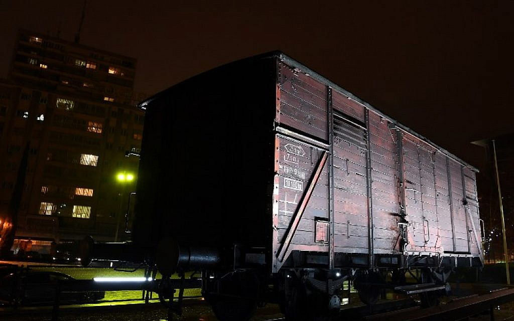 A wagon used to transport Jews to the Nazi death camps is displayed at the exhibition 'Auschwitz. Not long ago. Not far away' on November 28, 2017 at the Arte Canal Exhibition Centre in Madrid. (AFP PHOTO / GABRIEL BOUYS