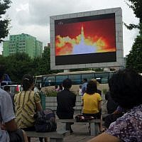 People watching as coverage of an ICBM missile test is displayed on a screen in a public square in Pyongyang, July 29, 2017. (AFP / Kim Won-Jin)