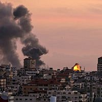 Illustrative: Smoke billows from a Palestinian Islamic Jihad position near Gaza City after Israeli aircraft bombed it on November 30, 2017, in retaliation to a mortar attack that targeted Israeli troops northeast of the Gaza Strip earlier in the day. (Mahmud Hams/AFP)