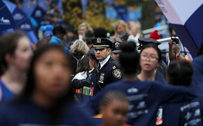A New York City police officer looks on during the 2017 TCS New York City Marathon in Central Park on November 5, 2017 in New York City.   (Elsa/Getty Images/AFP)