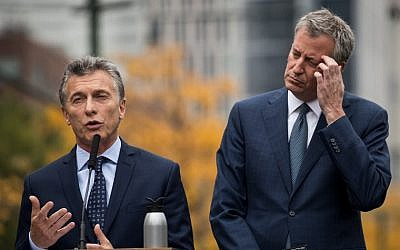 Argentinian President Mauricio Macri (L) speaks as New York City Mayor Bill de Blasio looks on during a tribute for the victims of last week's vehicular attack on the bike path next to the West Side Highway in Lower Manhattan, November 6, 2017 in New York City. (Drew Angerer/Getty Images via AFP)