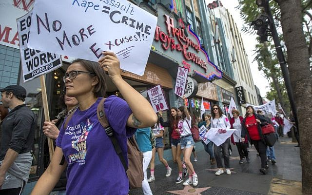Illustrative: Demonstrators participate in the #MeToo Survivors' March in response to several high-profile sexual harassment scandals on November 12, 2017 in Los Angeles, California. (David McNew/Getty Images/AFP)