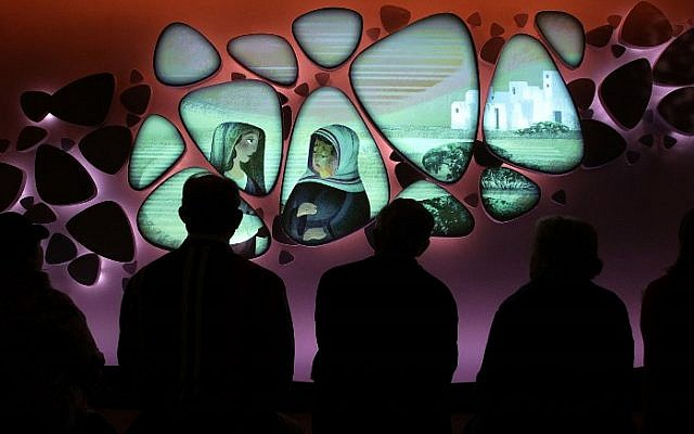 Visitors go through an exhibit on the Old Testament at Museum of the Bible November 15, 2017 in Washington, DC. The 430,000-square-foot museum, with a purpose to invite people to engage with the Bible, will be opened to the public on November 17, 2017.  ( Alex Wong/Getty Images/AFP)