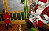 Guests visit Santa at Macy's Herald Square Santaland on November 17, 2017 in New York City. (Mike Coppola/Getty Images for Macy's/AFP)