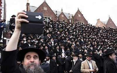 Hasidic rabbis prepare to pose a group photo, part of the annual International Conference of Chabad-Lubavitch Emissaries, in front of the group's World Headquarters, November 19, 2017, in Crown Heights, Brooklyn, New York. (Amir Levy/Getty Images/AFP)