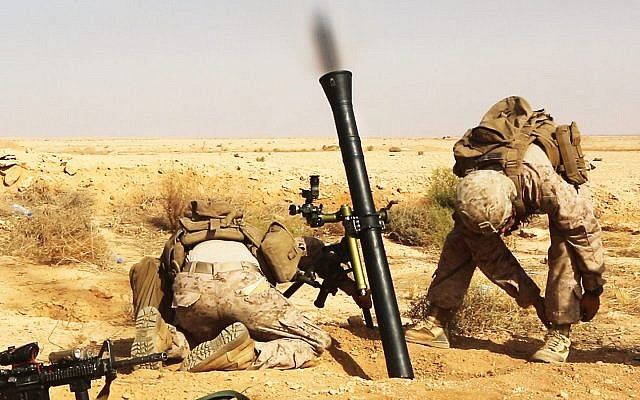 US Marines fire a M252A2 81 mm mortar system during a live-fire training mission at Al Asad Air Base, Iraq, October 24, 2015. (Illustrative: US Marine Corps/Sgt. Owen Kimbrel)