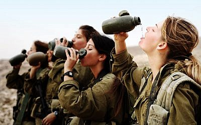 Illustrative. Female soldiers in the army's Infantry Instructors course take a water break during an exercise on November 19, 2007. (Israel Defense Forces/Flickr)