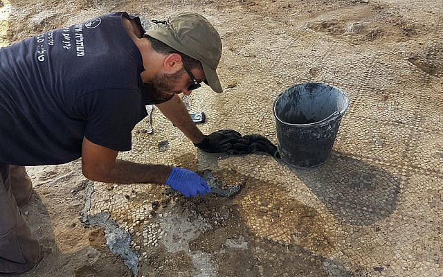 Working on the 1,500-year-old mosaic at Ashdod-Yam. (Anat Rasiuk, Israel Antiquities Authority)