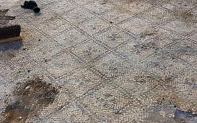 Working on the 1,500-year-old mosaic at Ashdod-Yam. (Anat Rasiuk, Israel Antiquities Authority)