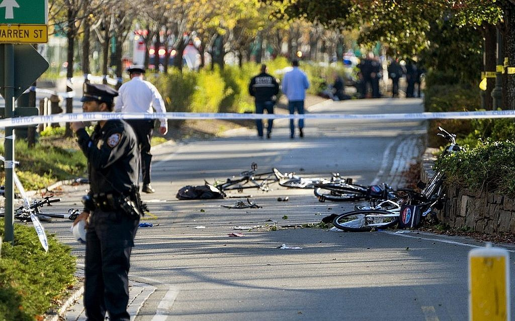 Bicycles and debris lies on a bike path after a motorist drove onto the path near the World Trade Center memorial, striking and killing several people Tuesday, Oct. 31, 2017.  (AP Photo/Craig Ruttle)