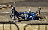 A bicycle lies on a bike path at the crime scene where a motorist earlier Tuesday drove onto the path near the World Trade Center memorial, striking and killing several people in a suspected terror attack, Wednesday, Nov. 1, 2017, in New York. (AP Photo/Andres Kudacki)