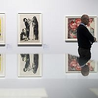 Two visitors in front of the paintings 'Junges Paar,', (l), and 'Diskussion' of German painter Emil Nolde, in the exhibition 'Status Report  Gurlitt. degenerate art -- confiscated and sold'  in the Kunstmuseum in Bern, Switzerland, Wednesday, November 1, 2017. (Peter Klaunzer/Keystone via AP)