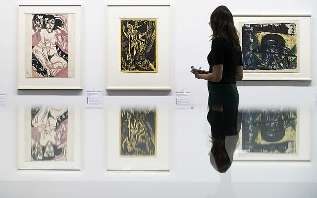 "A visitor watches the paintings ""Melancholisches Maedchen"", left, and Nackte Frau im Walde"" of German painter Ernst Ludwig Kirchner, in the exhibition 'Status Report Gurlitt.  degenerate art - confiscated and sold'  in the Kunstmuseum in Bern, Switzerland, Wednesday, November 1, 2017. (Peter Klaunzer/Keystone via AP)"
