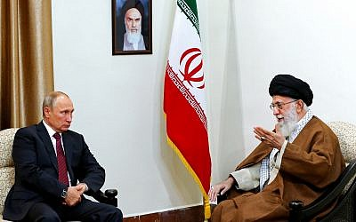 In this picture released by the office of the Iranian supreme leader, Supreme Leader Ayatollah Ali Khamenei, right, speaks with Russian President Vladimir Putin during their meeting in Tehran, Iran, Wednesday, Nov. 1, 2017. (Office of the Iranian Supreme Leader via AP)