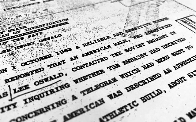 "Part of a file from the CIA, dated Oct. 10, 1963, details ""a reliable and sensitive source in Mexico"" report of Lee Harvey Oswald's contact with the Soviet Union embassy in Mexico City, that was released for the first time on Friday, Nov. 3, 2017, by the National Archives. (AP Photo/Jon Elswick)"
