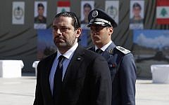 In this photo taken on Friday, Sept. 8, 2017, Lebanese Prime Minister Saad Hariri, left, arrives for a mass funeral of ten Lebanese soldiers at the Lebanese Defense Ministry, in Yarzeh near Beirut, Lebanon. (AP Photo/Hassan Ammar)