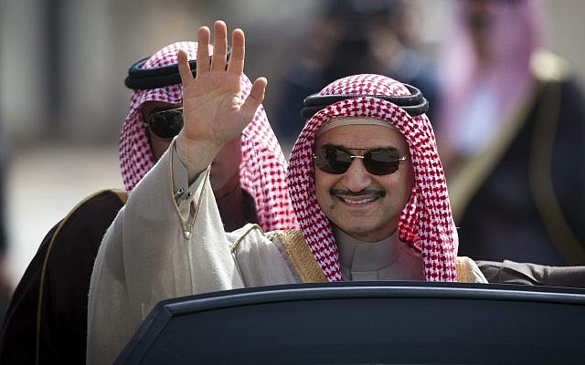 In this file photo from Feb. 4, 2014, Saudi billionaire Prince Alwaleed bin Talal waves as he arrives at the headquarters of Palestinian Authority President Mahmoud Abbas in the West Bank city of Ramallah. (AP Photo/Majdi Mohammed, File)