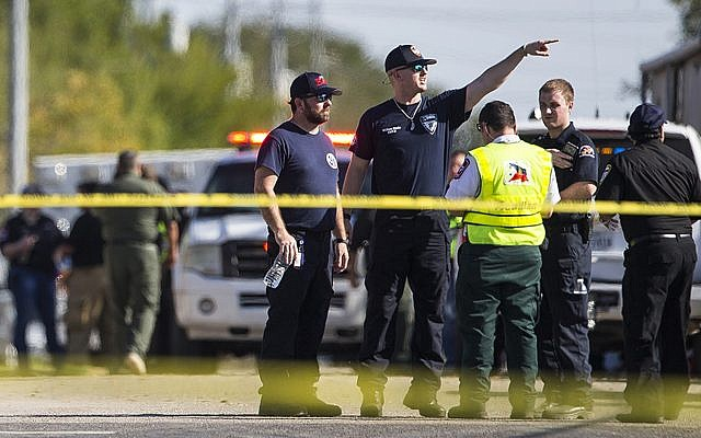 Law enforcement officials work the scene of a fatal shooting at the First Baptist Church in Sutherland Springs, Texas, on November 5, 2017. (Nick Wagner/Austin American-Statesman via AP)