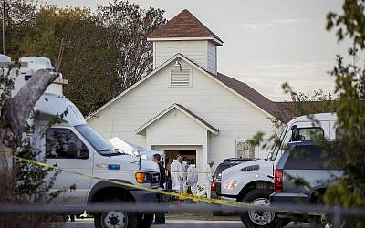 Investigators work at the scene of a deadly shooting at the First Baptist Church in Sutherland Springs, Texas, Sunday Nov. 5, 2017. (Jay Janner/Austin American-Statesman via AP)