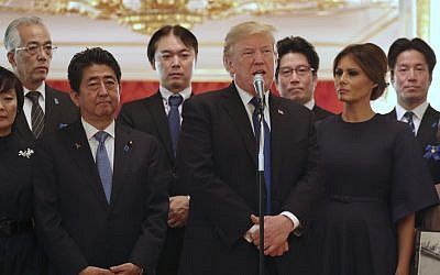 US President Donald Trump, center, speaks as Trump and first lady Melania Trump, right,  meet with the families of Japanese abducted by North Korea at the Akasaka Palace, November 6, 2017, in Tokyo. (AP Photo/Andrew Harnik)