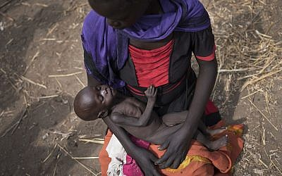 Adel Bol, 20, cradles her 10-month-old daughter Akir Mayen at a food distribution site in Malualkuel, in the Northern Bahr el Ghazal region of South Sudan, April 5, 2017. (AP)