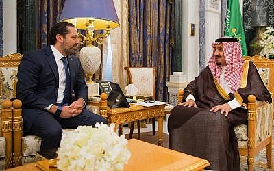In this photo provided by the Saudi Press Agency, Saudi King Salman, right, meets with outgoing Lebanese Prime Minister Saad Hariri in Riyadh, Saudi Arabia, Monday, Nov. 6, 2017. (Saudi Press Agency, via AP)